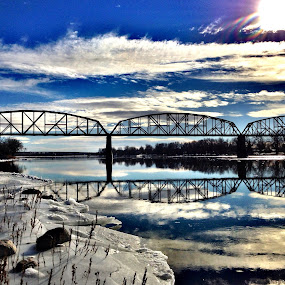 Reflecting Bridge by Dustin White - Instagram & Mobile iPhone ( clouds, water, reflection, bridge, landscape, river, snow, winter, cold )