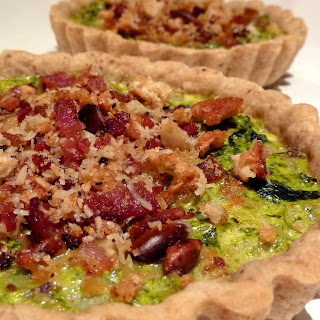 Kale and Kumquat Tarts with a Pancetta Streusel in a Toasted Pumpkin Seed Crust.