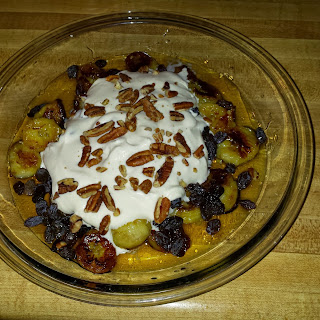 Fried Bananas in Honey-Apple Sauce with Raisins, Whipped Cream, and Pecans