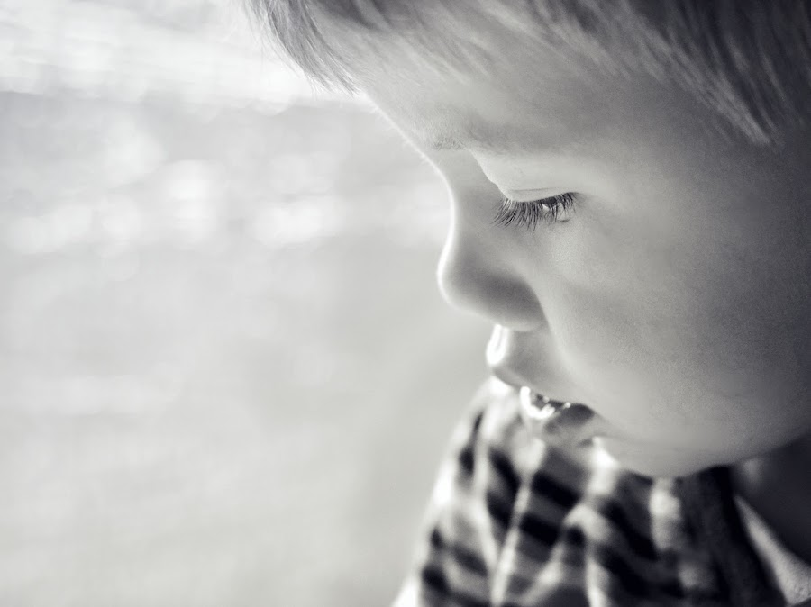 In the Sunlight by Melanie Pista - Babies & Children Child Portraits ( face, black and white, eyelashes, sunlight, bokeh, boy, eyes )
