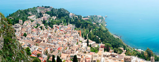 Italy-Taormina-Sicily-panorama - Taormina, on the east coast of the island of Sicily, Italy, has been a popular tourist destination for 200 years.