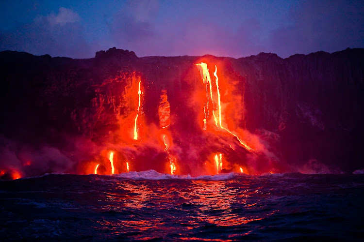 Hot magma flows into the Pacific from a volcanic eruption on the Big Island of Hawaii.