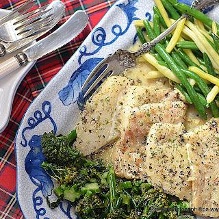 Sauteed Cod In Greek Seasoned Butter Wine Sauce.