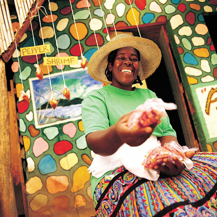 A vendor selling pepper shrimp in Jamaica.
