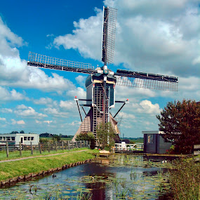 Blue wip windmill by Pete Bobb - Buildings & Architecture Public & Historical ( clouds, reflection, blue, holland, wip, achthovense, windmill,  )