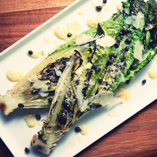 Grilled Romaine Hearts with Fried Capers & Lemon Cream.