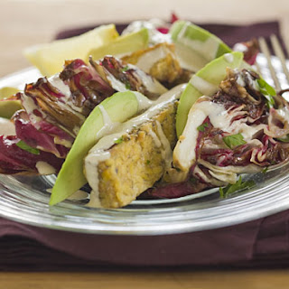 Grilled Marinated Tempeh Steak with Avocado, Radicchio, Orange Dressing, and Tahini.