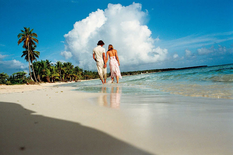 Walk barefoot in the surf during a Windstar Cruise odyssey to the tropics.