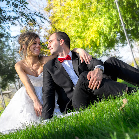 in a park by Jovan Barajevac - Wedding Bride & Groom ( looking, love, grass, happy, green, smile, bride, groom )