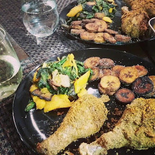 Fried Jerk Chicken with Collared Greens and Plantains.