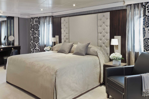 Regent-Seven-Seas-Navigator-Master-Suite-bedroom - At a sumptuous 1,021 to 1,173 square feet, the stylish Master Suites on Seven Seas Navigator feature a king bed, 1 1/2 marble bathrooms, private balcony, expansive living room, walk-in closet with safe, flat screen TV, mini-bar, personal butler and complimentary use of iPad.