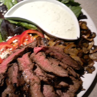 Flank Steak with Mushrooms and a Gorgonzola Basil Dressing.