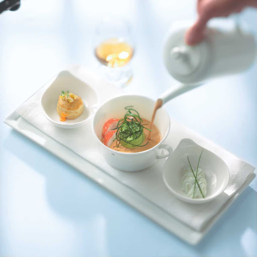 Murano Lobster Bisque - The lobster bisque being presented at Murano on Celebrity Cruises.