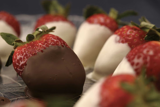 Fresh strawberries dipped in rich chocolate presented during a cruise on Regent Seven Seas.