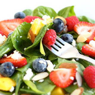 Spinach Salad with Fruit, Almonds, and Feta Cheese.