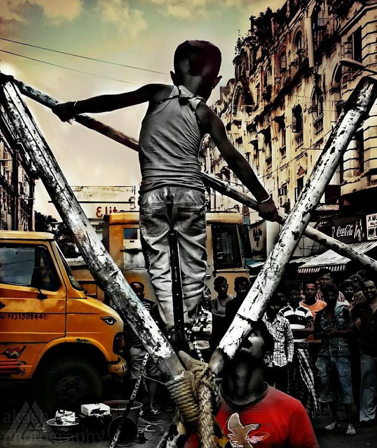 #street_photography #child #talent #balancing_on_cycle_rim #on_rope #mob_pic #elite #heart_of_the_city #kolkata #west_bengal #beautiful_INDIA#full_screen_view_recomended :)1n more thing which I missed out was #worried_father by Akash Gupta - City,  Street & Park  Street Scenes ( street, people )