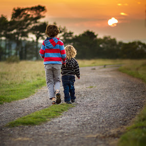 Brothers by Keren Woodgyer - Babies & Children Toddlers ( walking, photograph, pathway, grass, togetherness, blond, behind, children, journey, travel, people, caucasian, child, love, curly, traveling, sunset, boy, footsteps, brothers )