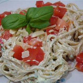 Creamy Pesto Pasta Salad with Chicken, Asparagus and Cherry Tomatoes.