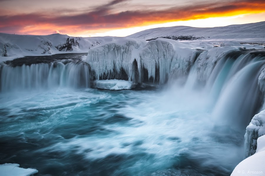 Steaming cold by Guðmundur Árnason - Landscapes Waterscapes ( goðafoss, colorful, snow, waterfall, fire in sky, frozen )