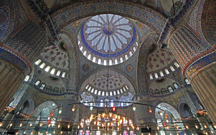The stunning interior of the 17th-century Sultan Ahmed Mosque in Istanbul, Turkey, popularly known as the Blue Mosque for the 20,000 blue tiles that adorn its walls.