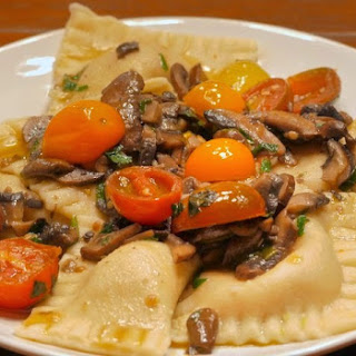 Bacon Filled Ravioli with Mushroom & Fresh Tomato Sauce.