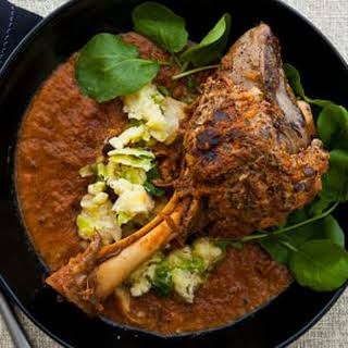 Braised Lamb Shanks with Chanterelle-Sausage Crust and Mashed Brussels Sprouts.