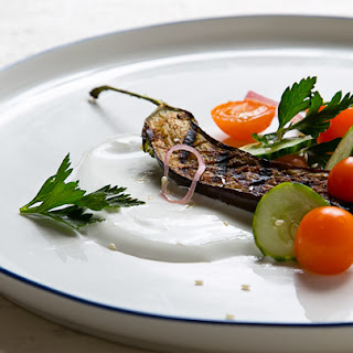 Grilled Spiced Eggplant with Yogurt and Tomato-Cucumber Salad.