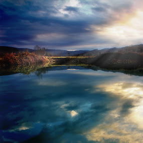 SAVE THE LAST RAY FOR ME by Paolo Lazzarotti - Landscapes Waterscapes ( mirrored reflections, hills, blue clouds, tuscany, sunset, rays of sun, lake, orange clouds, painting,  )