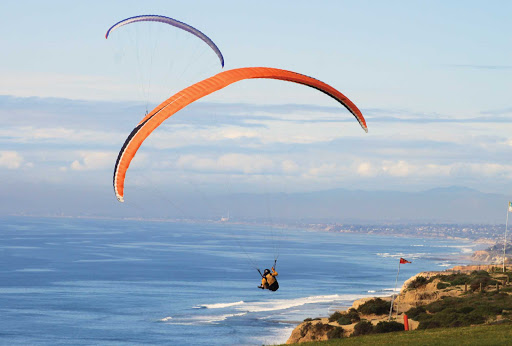 Parakiting over Torrey Pines near San Diego, California.