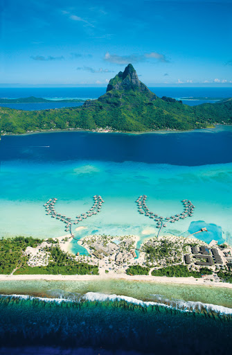 BoraBora_Thalasso_aerial - Soak in the views from Bora Bora's lagoon to Mount Otemanu and beyond at the InterContinental Bora Bora Resort, a highlight of the Paul Gauguin cruise.