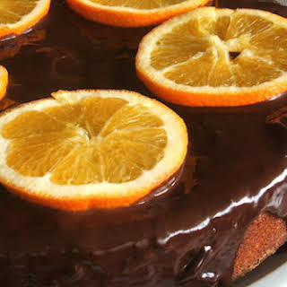 Orange Cake Topped With Chocolate Sauce.