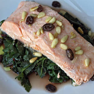 Steamed Salmon with Chard, Pine Nuts, and Raisins.