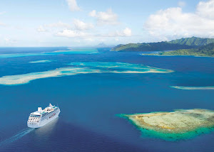 Ocean Princess — the smallest ship in the Princess fleet alongside her twin, Pacific Princess — sails through the emerald lagoon of Taha'a in French Polynesia.