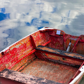 An old orange dingy by David Stone - Transportation Boats ( clouds, water, reflection, peeling paint, rowboat, dingy, rockport,  )