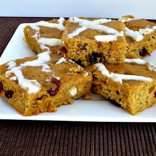 Pumpkin Bars with White Chocolate and Dried Cranberries.