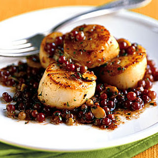 Pan-Seared Scallops with Champagne Grapes and Almonds.