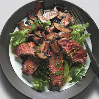 Seared Asian Steak and Mushrooms on Mixed Greens with Ginger Dressing.