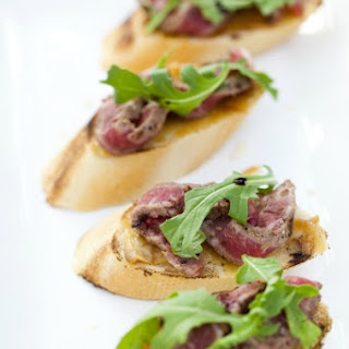 Roasted Garlic Rib Eye Crostini