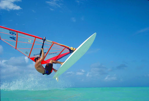 Aruba-windsurfing2 - An experienced windsurfer catches some air on Aruba.
