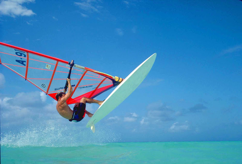 An experienced windsurfer catches some air on Aruba.