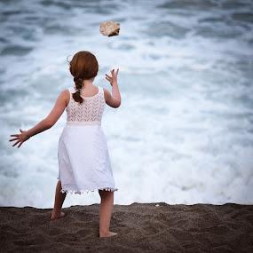 How far can I throw this? by . Reedd2 - Babies & Children Children Candids ( throw, girl, sad, white dress, sea, rock, surf )
