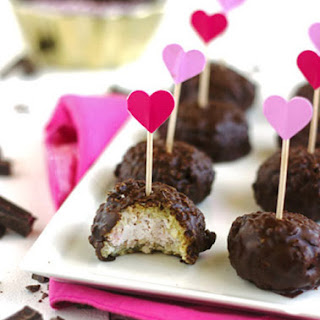 Raspberry Cheesecake Stuffed Coconut Quinoa Bites with Dark Chocolate Glaze {Gluten free}.