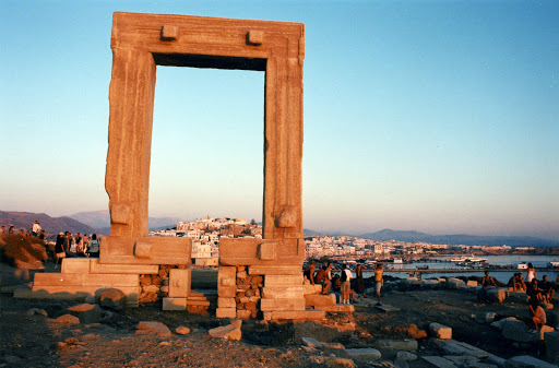 Temple-of-Apollo-Naxos - Children play at sunset on the Temple of Apollo on the island of Naxos, where hundreds of visitors gather at sundown every night. The huge marble portal was begun in 522 B.C. on the orders of the tyrant Lygdamis but never completed.