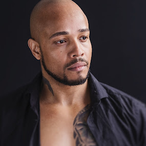 Andre Laconic Carter by Shaheen Razzaq - People Portraits of Men ( headshot, open shirt, male, tattoo, man )