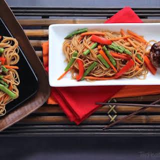 """Hoisin-Glazed Mini Meatloaf """"Muffins"""" Over Asian Noodles and Vegetables."""