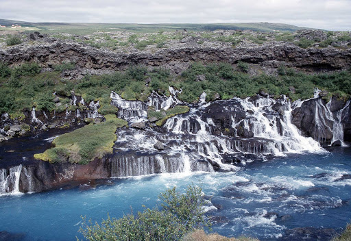 Hraunfossar is a series of waterfalls formed by rivulets streaming over rocks in Iceland.