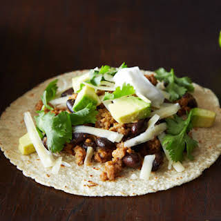 Coconut-Lime Pork Tacos with Black Beans and Avocado.