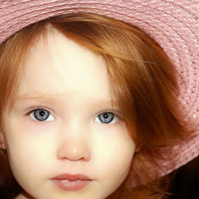 Nevaeh in a Purple Hat by Cheryl Korotky - Babies & Children Child Portraits ( model, children in hats, straw, a heartbeat in time photography, beautiful, nevaeh, pretty, child, purple hats, easter, red hair, blue eyes, baby, easter bonnet, face, photography, closeup, close, up,  )