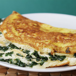 Soufflé Omelet with Robiola and Sautéed Ramps.