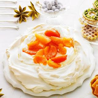 Pavlova with Vanilla-Poached Oranges Recipe